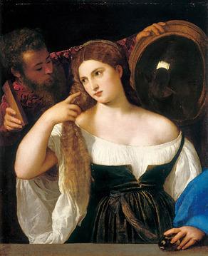 鏡の前の女