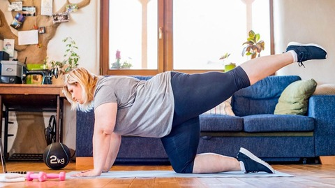 woman_working_out_at_home-1296x728-body-1296x728