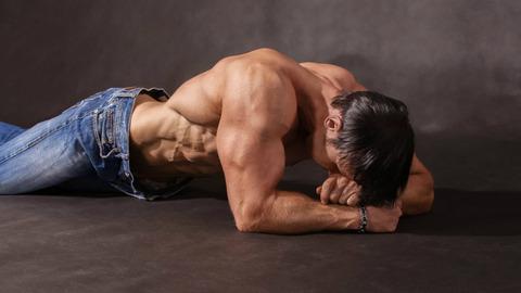 tired-bodybuilder-lying-floor