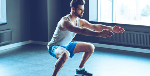 man-in-sportswear-doing-squat-at-gym