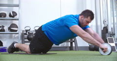 man-working-out-ab-roller-footage-056212399_iconm