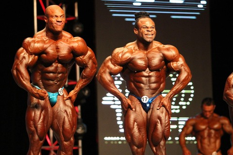 2048px-Phil_Heath_Kai_Greene-56a0b0513df78cafdaa40057