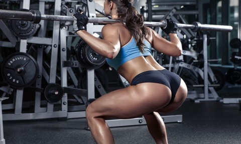 Woman-Doing-Squat-Workout-For-Legs-694x417