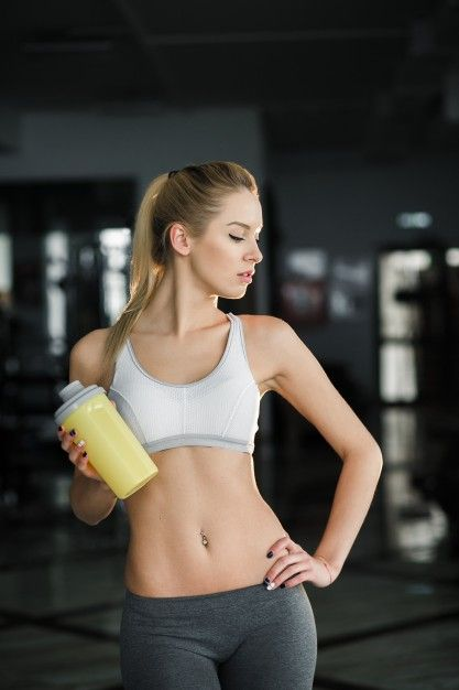 sexy-woman-with-yellow-bottle-gym_1153-962