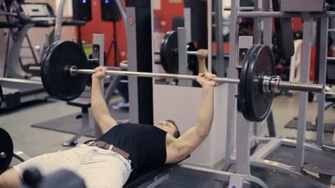 depositphotos_93898522-stock-video-man-doing-bench-press-workout