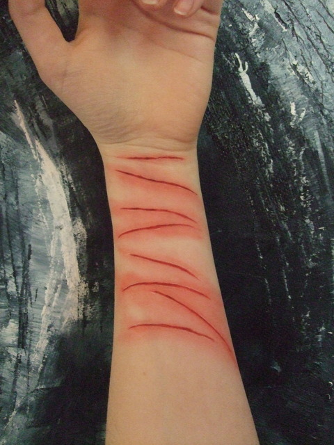the_wrist_of_a_cutter_by_panicface-d3im2yi