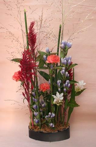 花ギフト フラワーギフト 誕生日 花 カノシェ話題 スタンド花 ウエディングブーケ 花束 花屋 かおるさん クルクマ
