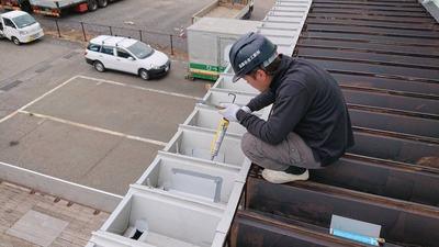 新潟県三条市の屋根外壁塗装リフォーム専門店 遠藤板金工業有限会社 倉庫庇折板屋根修理