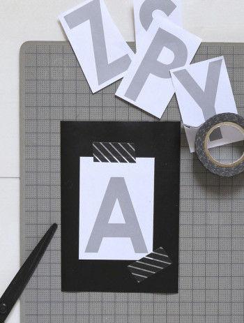 カッティングシートに型紙になる文字を止めて切り抜きます。 直線はカッターで定規を当ててきれいに切ります