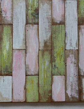 アクリル絵の具が乾いたら、ベニヤ板に木工用ボンドで貼りつけます。