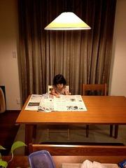 新聞を詠む人