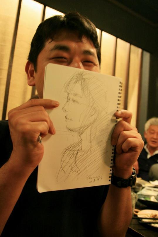 23徳田さん似顔絵宴会