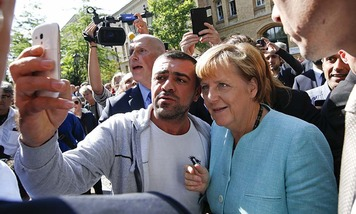 Merkel with Strian refugee
