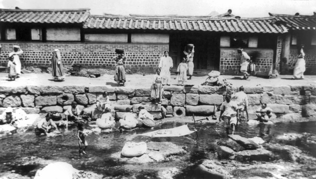 Korean Women washing laundry in stream
