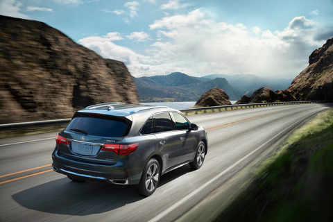 2017-Acura-MDX-rear-three-quarter-in-motion-01