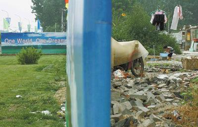 北京五輪キャッチフレーズ「ひとつの世界、ひとつの夢」の裏側