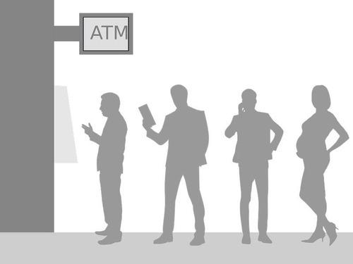 ATMの利用客を見つめる猫
