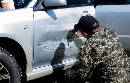 ロシアのぶつけられた車を変身02
