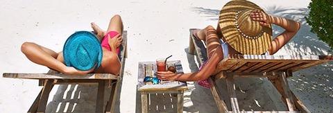 couple_relaxing_beach_542x184