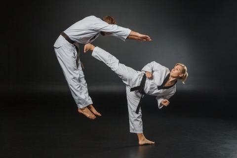 karate-martial arts-sports-man ando woman-kick