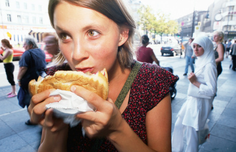 148590354-girl-eating-doner-kebab-in-kreuzberg-gettyimages