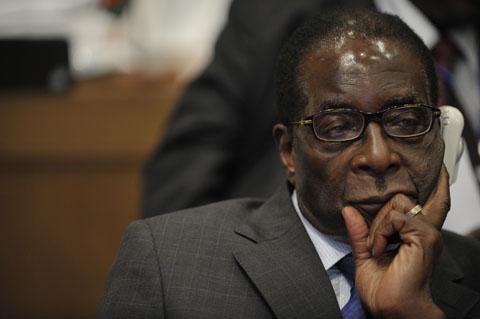Robert_Mugabe,_12th_AU_Summit,_090202-N-0506A-411