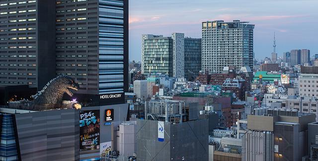 The-Godzilla-head-peeking-out-from-above-Hotel-Gracery-Shinjuku