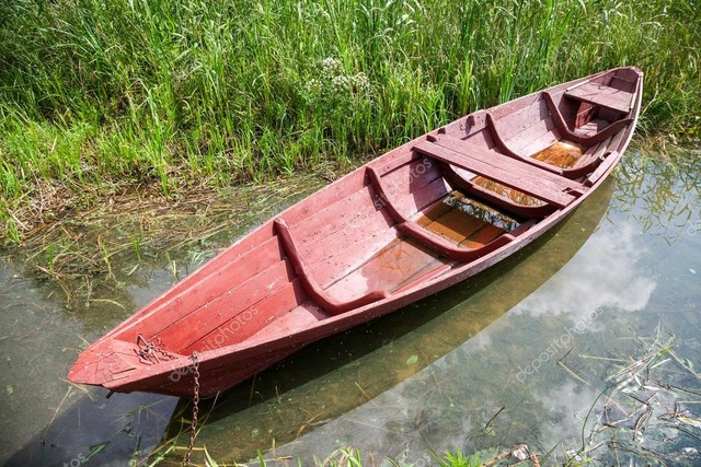 depositphotos_83035596-stock-photo-old-red-wooden-boat-at