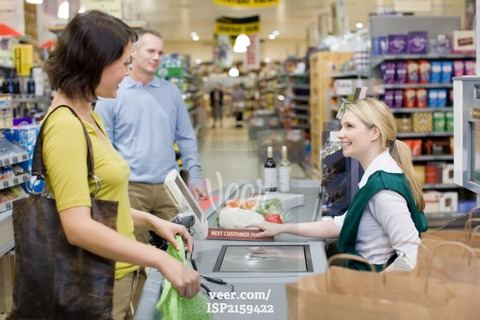 Cashier-and-customers-at-supermarket-ISP2159422