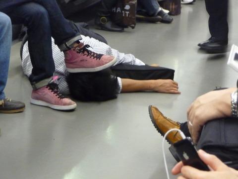 sleeping-salaryman-on-train-floor