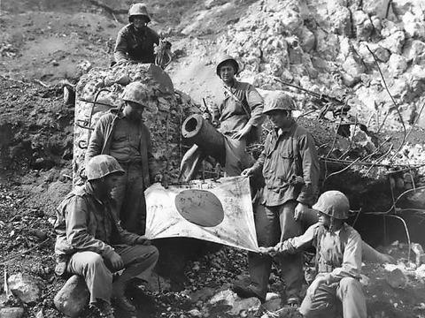 Captured_Japanese_flag_on_Iwo_Jima