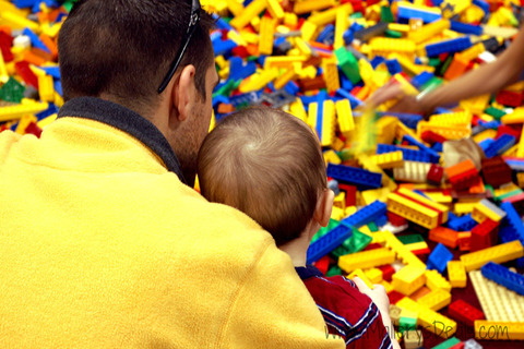 Playing-in-a-pile-of-LEGO-blocks-at-LEGO-Kidsfest