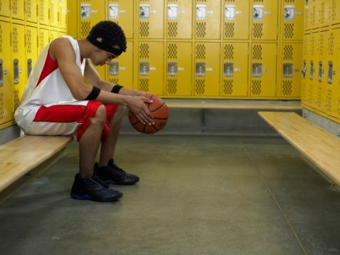sad_basketball_player_in_locker_room_0