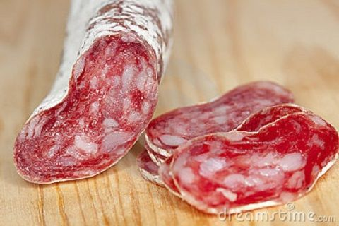 spanish-fuet-salami-cuts-wooden-board-10308344