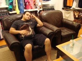 holding-a-purse-on-the-man-couch