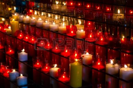 20096035-burning-candles-in-a-church