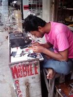 携帯電話の修理屋