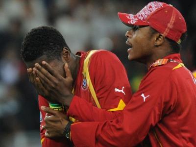 s_Uruguay-v-Ghana-Asamoah-Gyan-hides-tears_2473480