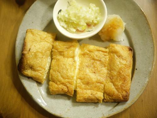 「その女、ジルバ」チーズと明太子でしこんでカリッと焼いた油揚げのネギ塩ソース添え