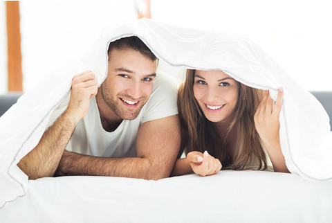 bigstock-Couple-under-bed-covers-91283300
