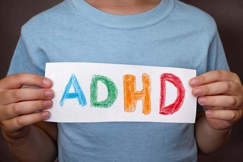 adhd-child-holding-notice