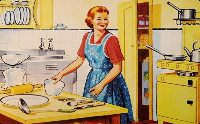 料理する母