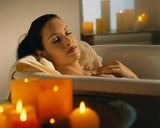 woman in bath with candles_full