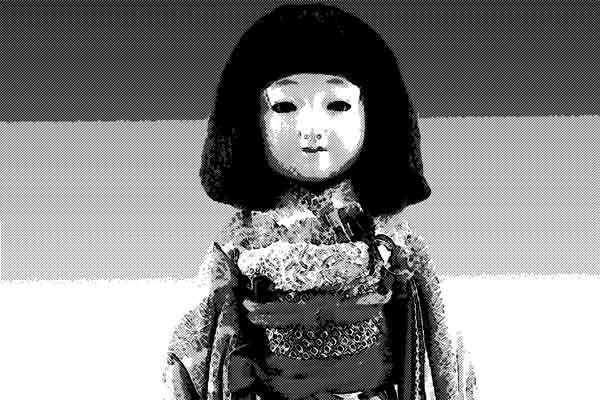 留守の新居を守った人形