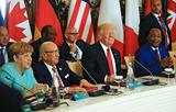 初めてのサミットに臨み満面の笑みのトランプ大統領