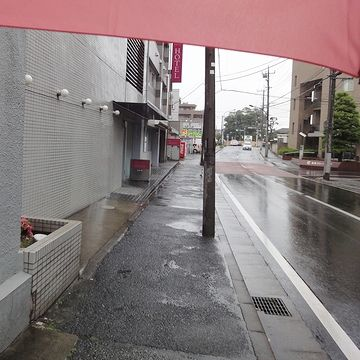 傘を差しての撮影が出来るのは、リュックならでは