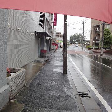 傘を差しながらの写真