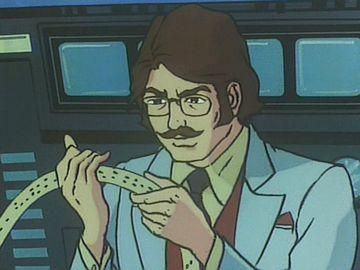 コンピューターの吐き出した紙テープを読む南部博士(ガッチャマン)。昔のマンガではよくあったシーンで、お茶の水博士も得意だったようです。