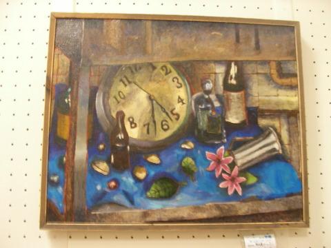 11魚住東中2年水道の下の時計とビンと花