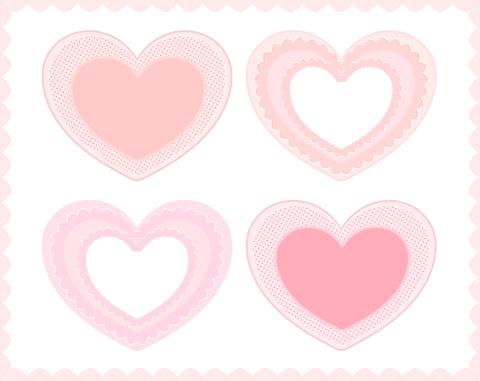 細かな模様の入った薄いピンクとコーラルピンクの装飾ハート素材